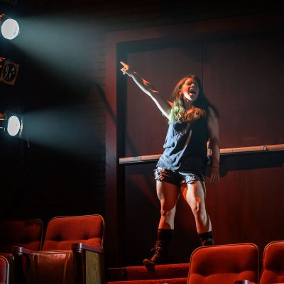 Amy Keating. Photo by Dahlia Katz. Set and Lighting by Nick Blais. Costumes by Anahita Dehbonehie.